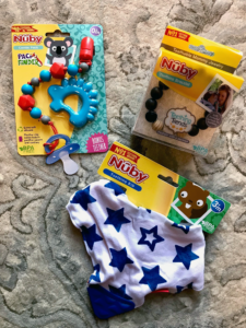 Reviews of Nuby Paci Finder Nuby Teething Bracelet Nuby Teething Bib Nuby Teethers